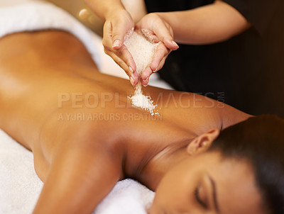 Buy stock photo Cropped shot of a young woman getting an exfoliating treatment at the spa