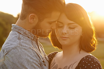 Buy stock photo Shot of an affectionate young couple outdoors