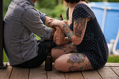 Buy stock photo Cropped shot of a tattooed hanging out together on the porch