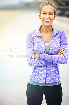 Buy stock photo Portrait of a young woman in sportswear standing at the beach
