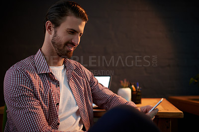Buy stock photo Cropped shot of a young businessman working overtime in his office