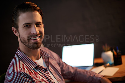 Buy stock photo Cropped portrait of a young businessman working overtime in his office