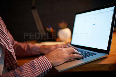Buy stock photo Cropped shot of a businessman working overtime in his office