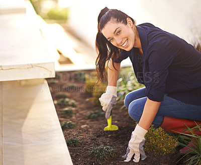 Buy stock photo Portrait of a young woman working in her garden