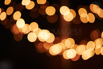Buy stock photo Shot of bright lights blurred in the background of a dark setting