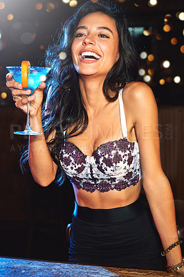Buy stock photo Shot of a young woman partying in a nightclub