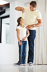 Young girl getting her height measured