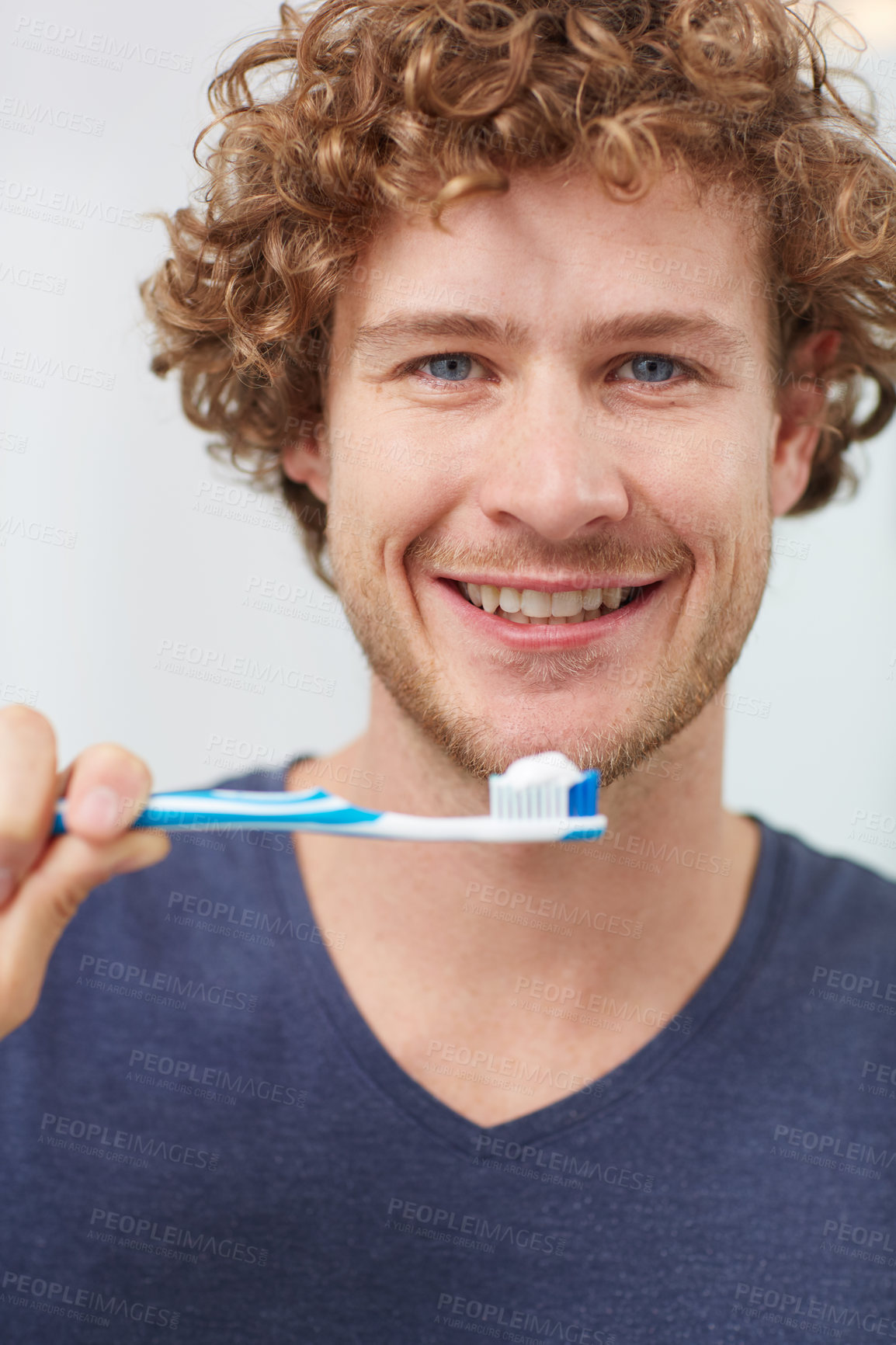 Buy stock photo Cropped portrait of a handsome young man holding his toothbrush