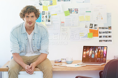 Buy stock photo Portrait of a young designer at work in his home office
