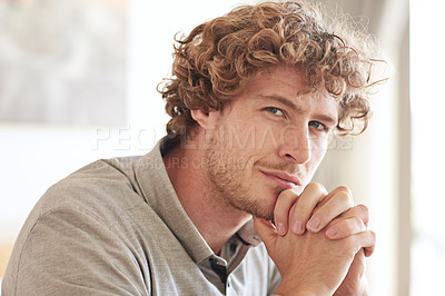 Buy stock photo Cropped portrait of a young businessman looking thoughtful while working at home
