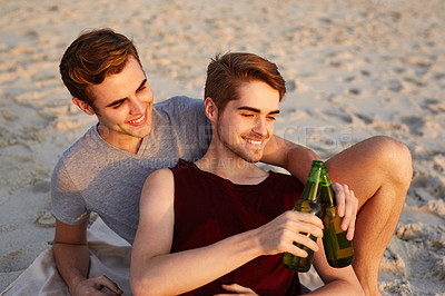 Buy stock photo Shot of a young couple enjoying  drinks at the beach