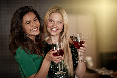 Buy stock photo Shot of two girlfriends partying in a nightclub