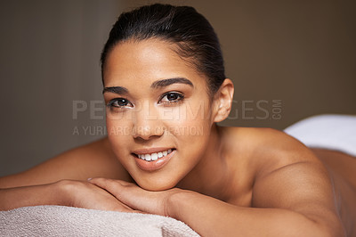 Buy stock photo Cropped portrait of a beautiful young woman relaxing during a spa treatment