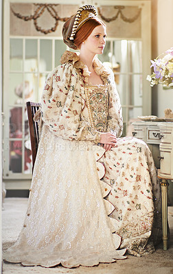 Buy stock photo Shot of an elegant noble woman in her palace room