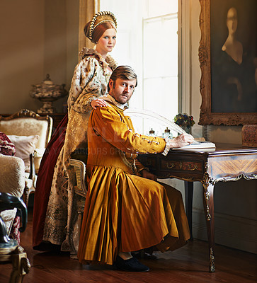 Buy stock photo Portrait of an aristocratic couple writing a letter at an ornate table
