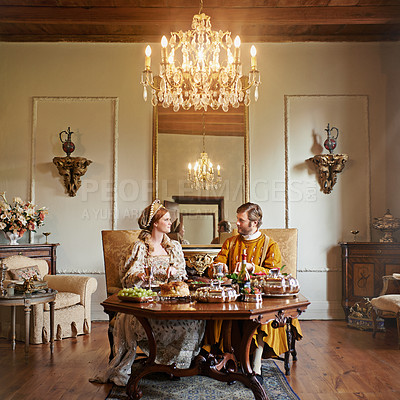 Buy stock photo Shot of a noble couple eating together in the palace dining room