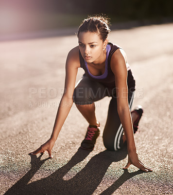 Buy stock photo Shot of a young woman in the starting position for a run