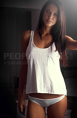 Buy stock photo Portrait shot of a beautiful young woman in a tank top and underwear