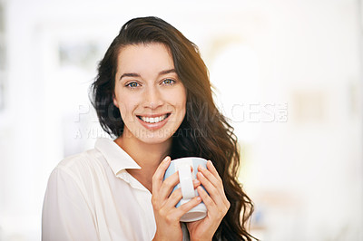 Buy stock photo Portrait of a happy young woman enjoying a cup of coffee