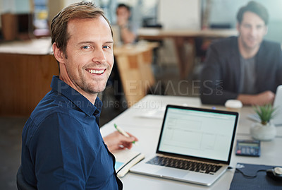 Buy stock photo Portrait of a designer working on a laptop in an office