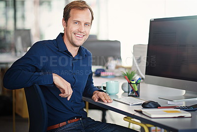 Buy stock photo Portrait of a designer sitting at his desk in an office