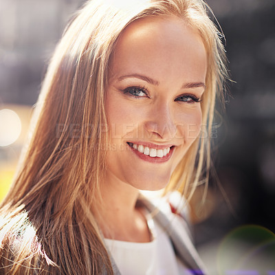 Buy stock photo Portrait of an attractive young woman in a city street