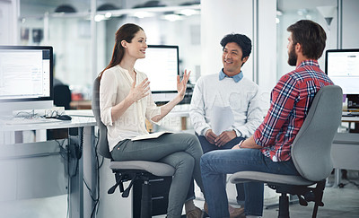 Buy stock photo Shot of a team of businesspeople having a meeting in the office