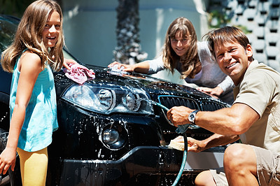 Buy stock photo Portrait of family washing their car and giving you an attractive smile