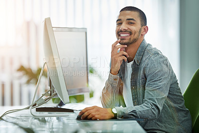 Buy stock photo Portrait of a young designer working at his computer in an office