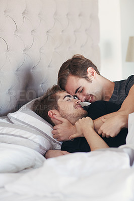 Buy stock photo Shot of an affectionate couple lying in bed