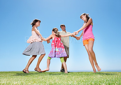 Buy stock photo Full length of family holding hands and walking in circle
