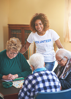 Buy stock photo Shot of a volunteer working with seniors at a retirement home