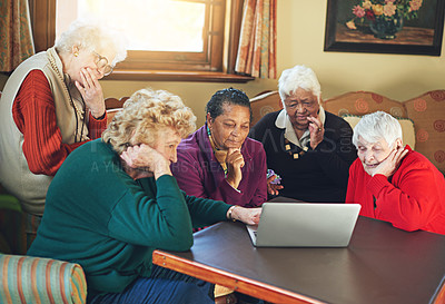 Buy stock photo Shot of a group of senior women using a laptop at a senior centre