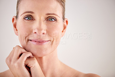Buy stock photo Cropped studio portrait of an attractive mature woman