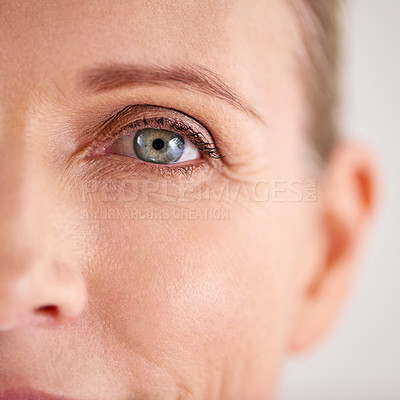 Buy stock photo Closeup shot of an attractive mature woman with the focus on her eyes