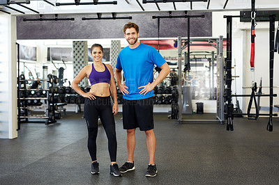 Buy stock photo Full length shot of two young people standing in the gym