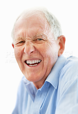 Buy stock photo Closeup portrait of a happy-looking senior smiling at the camera