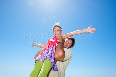 Buy stock photo Portrait of man lifting his daughter and smiling - copyspace