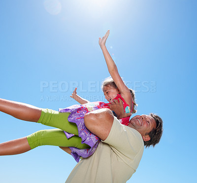 Buy stock photo Father standing against sky and lifting his daughter
