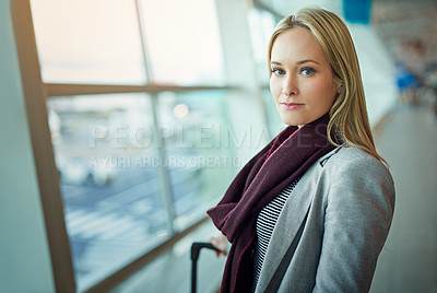 Buy stock photo Portrait of a young woman standing in an airport