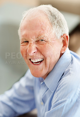 Buy stock photo Closeup portrait of a laughing senior smiling at the camera