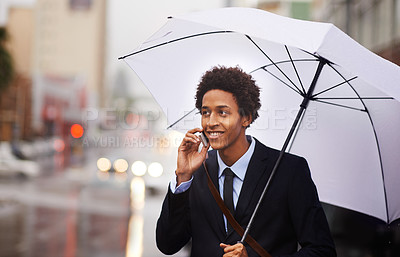 Buy stock photo Shot of a businessman using his cellphone on the way to work