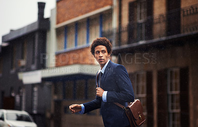 Buy stock photo Shot of a businessman in an urban setting