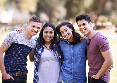 Buy stock photo Portrait of a group of happy young friends spending time together outdoors