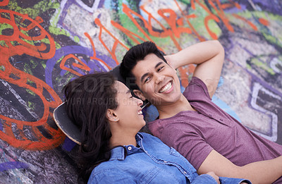 Buy stock photo Shot of a young couple hanging out together at a skatepark