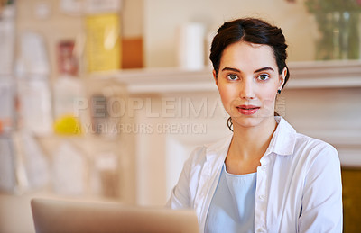 Buy stock photo Portrait of a young businesswoman working from home
