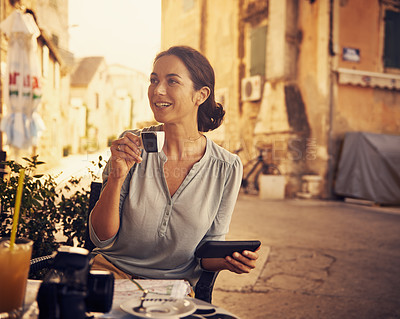 Buy stock photo Shot of a woman enjoying a cup of coffee at a cafe