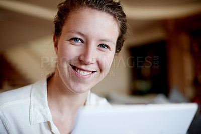 Buy stock photo Cropped portrait of a young woman using her laptop a at home