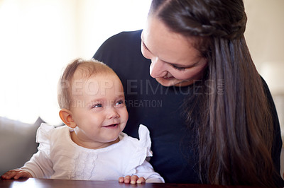 Buy stock photo Shot of a mother and her baby daughter at home