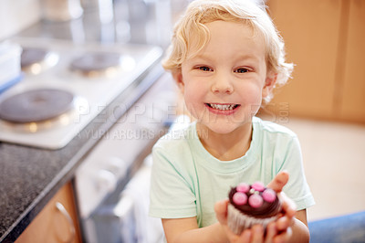 Buy stock photo Portrait of a little boy holding a cupcake